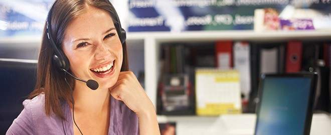 woman working at desk wearing headset